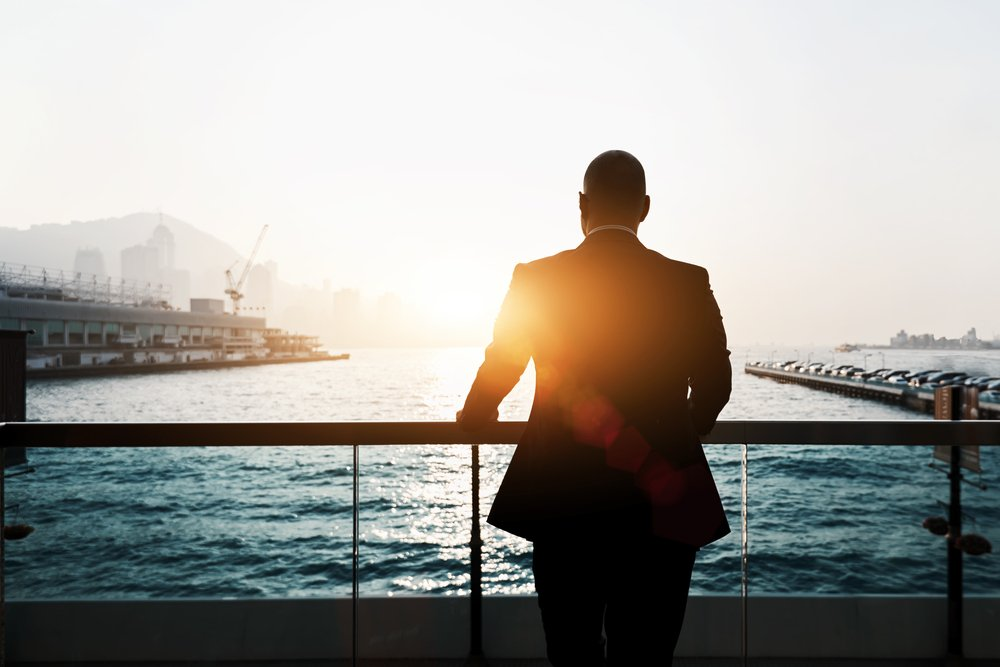Businessman enjoying sunset
